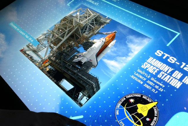 Unified Field Interactive Studio designed the Kennedy Space Center Space Shuttle Atlantis Attraction digital interactives including this multitaction media wall detailing the history of the Space Shuttle.