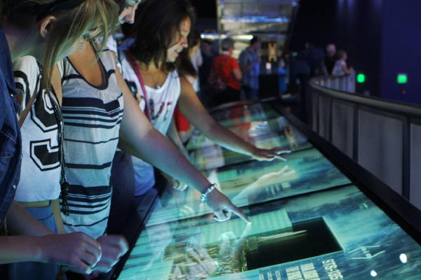 The Space Shuttle media wall at the Space Shuttle Atlantis Attraction is a touch screen multimedia interactive time line of the entire space shuttle program.