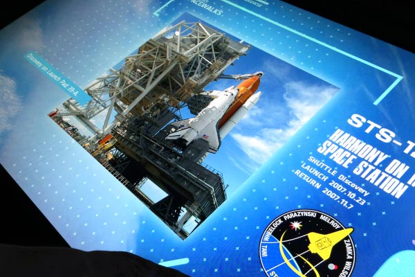 The Space Shuttle media wall at the Space Shuttle Atlantis Attraction is a touch screen interactive time line of the entire space shuttle program.