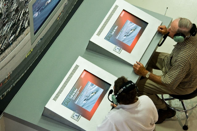 This interactive created by Unified Field allows guests at the ASCAR hall of fame to call an interactive NASCAR race.