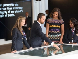 Michelle Obama investigates Unified Field's interactive multiouthouch table at the American Pavillion, Expo Milano.