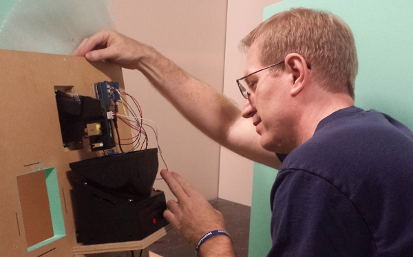 Jeff Miller installs Arduino-driven hardware for the Game Show at Neurosociety